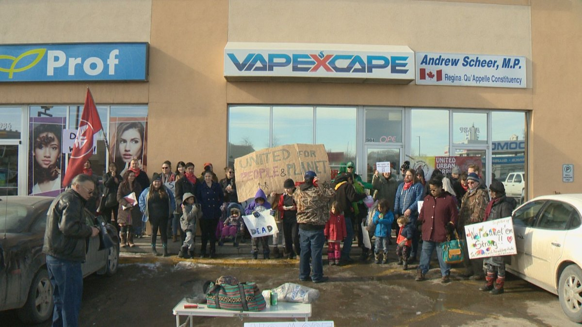 Protesters rally in front of Conservative Leader Andrew Scheer's constituency office in Regina on Feb. 22.