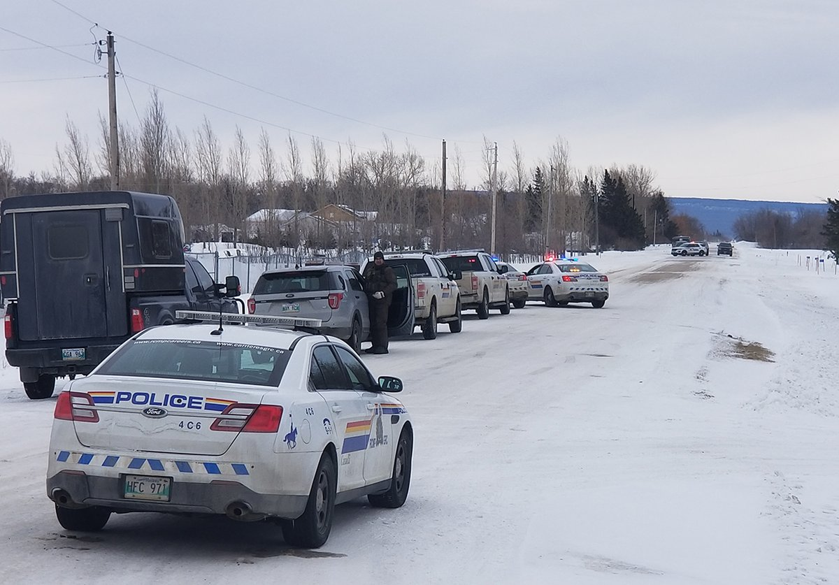 Manitoba RCMP at a home in Eclipse, Man.