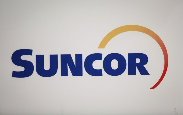 Suncor Energy Inc. logo at the company's annual meeting in Calgaryo on April 27, 2017. Suncor Energy Inc. says its on-again, off-again plan to add a coker unit to its Montreal refinery to allow it to process heavier barrels of oil, including oilsands bitumen, is off the table again as it shuffles priorities in its long list of production growth projects. THE CANADIAN PRESS/Jeff McIntosh.
