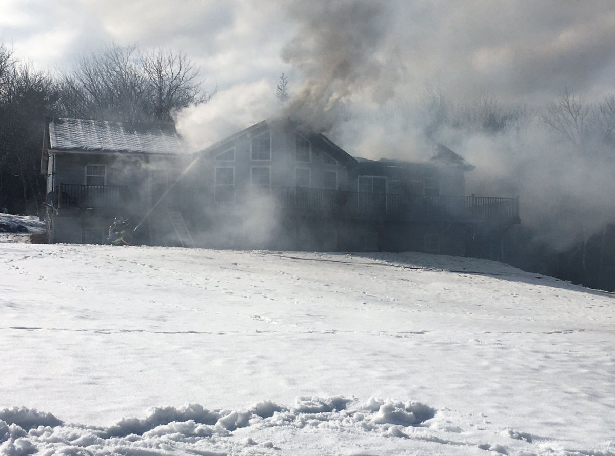 Halifax Regional Fire and Emergency crews work to put out a blaze on Terance Bay Road on Monday, Feb. 17, 2020.