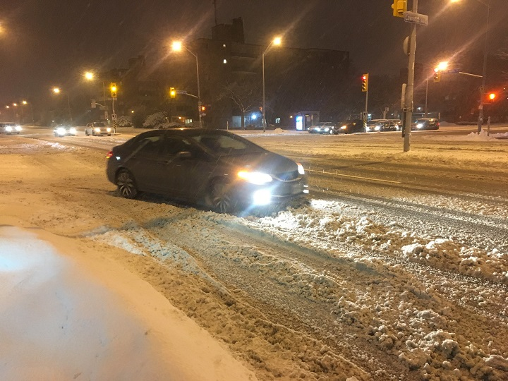 Drivers on Toronto roads as snow and rain fall over the city on Tuesday morning.