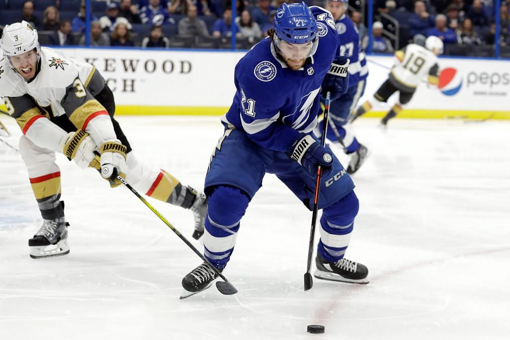 Tampa Bay Lightning centre Brayden Point (21) loses the puck to a stick-check by Vegas Golden Knights defenceman Brayden McNabb (3) during the second period of an NHL hockey game Tuesday, Feb. 4, 2020, in Tampa, Fla.