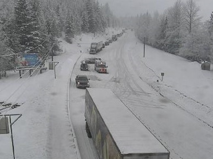 A photo from DriveBC showing a lineup of vehicles along the Trans-Canada Highway at Three Valley Gap in B.C.'s Southern Interior. The Trans-Canada Highway west of Revelstoke was closed on Saturday morning because of a major vehicle incident. Police now say two people died in the collision.