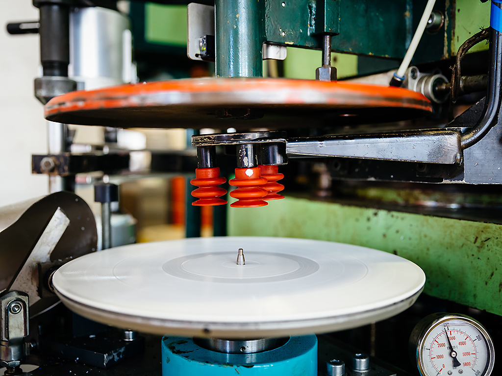 Close-up shot of a pressing machine for vinyl records.