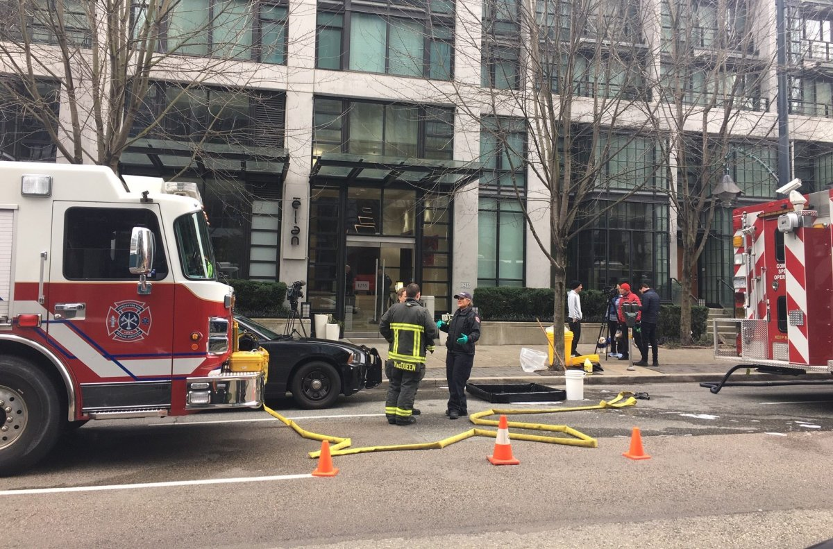 Vancouver fire crews, hazmat and police descend on a downtown apartment building as police execute a search warrant connected to a drug investigation on Feb. 16, 2020.