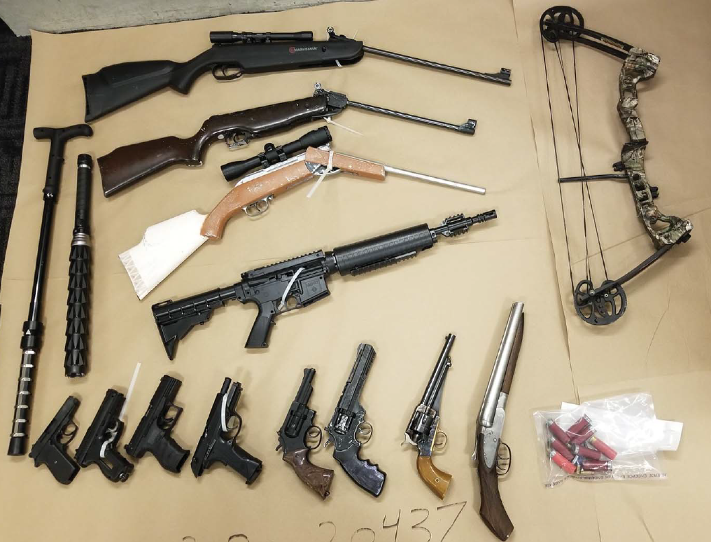 Guns, pellet guns, stun batons and a compound bow seized by police as a part of a property crime investigation.