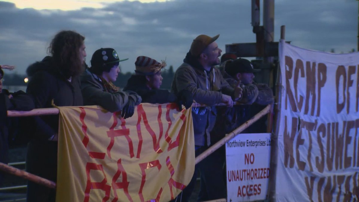 Activists with the Red Braid Alliance block rail tracks in Maple Ridge on Monday, Feb. 24, 2020.