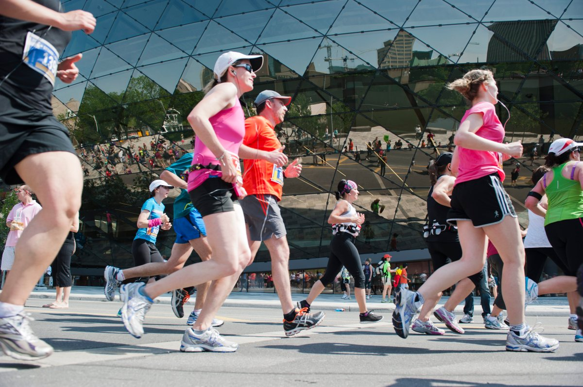 Runners taking part in the Ottawa Race Weekend half-marathon are seen in front of the Shaw Centre downtown on Sunday, May 27, 2012.