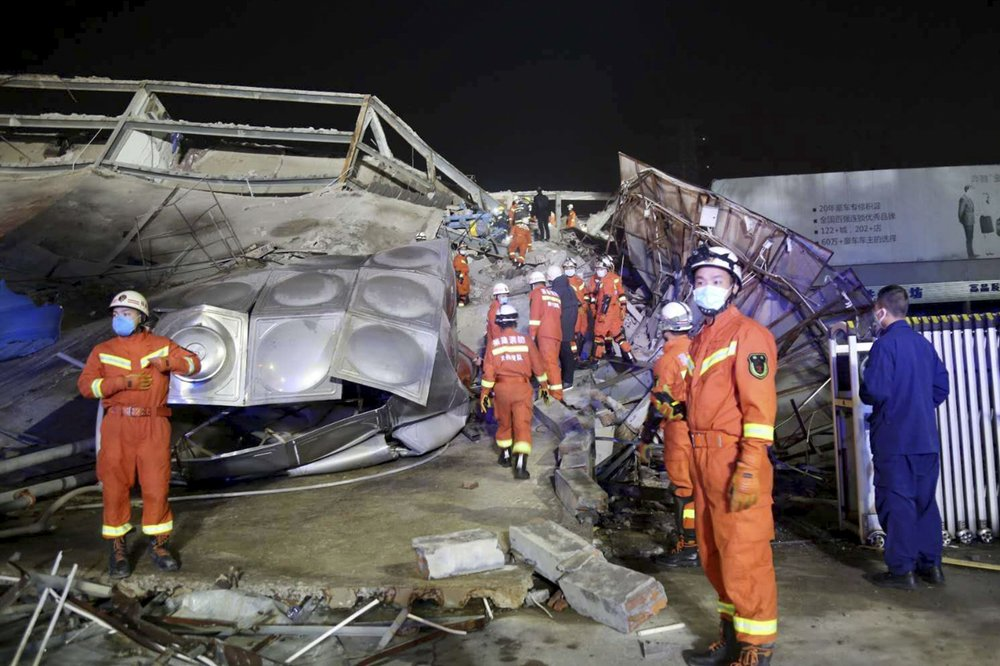 Rescuers work at the site of a collapsed five-story hotel building in Quanzhou city in southeast China's Fujian province Saturday, March 7, 2020. The hotel used for medical observation of people who had contact with coronavirus patients collapsed in southeastern China on Saturday, trapping dozens, state media reported.