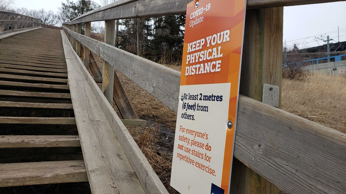 A sign posted at the Royal Glenora staircase in Edmonton's River Valley.