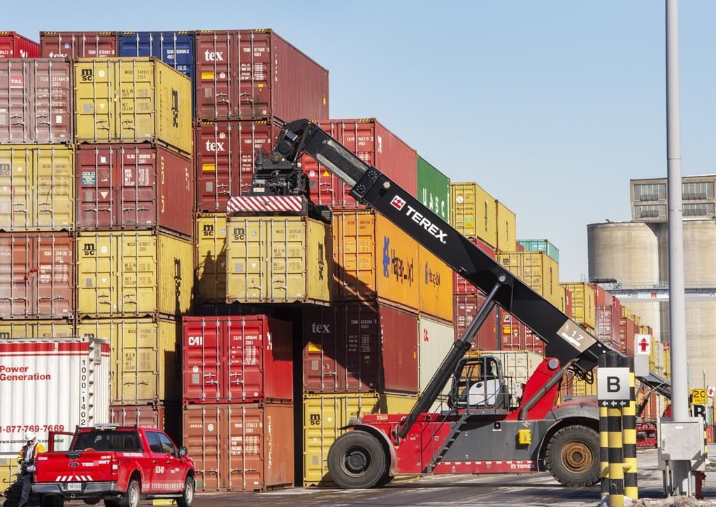 In this file photo, containers are stacked at the Port of Montreal. Checkers working at the Port of Montreal have voted in favour of a renewed collective agreement. Monday, Aug. 24, 2020.