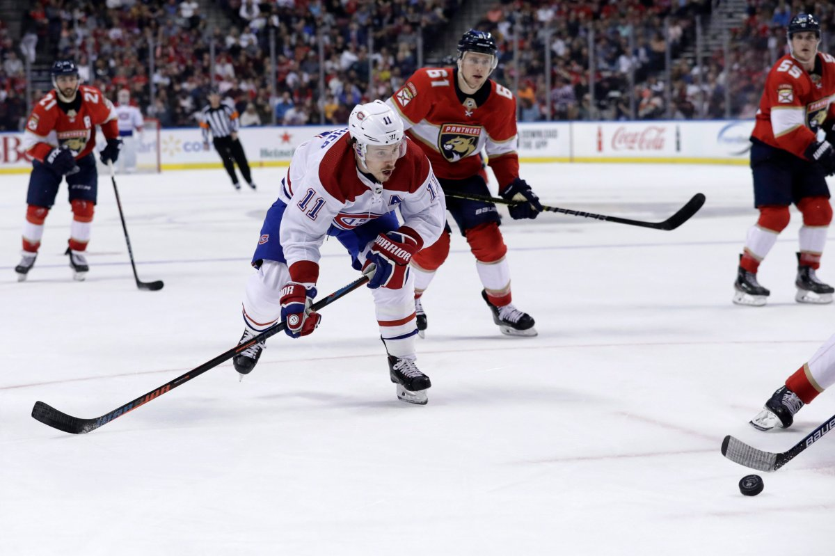 Montreal Canadiens right wing Brendan Gallagher (11) goes for the puck during NHL hockey game against the Florida Panthers.