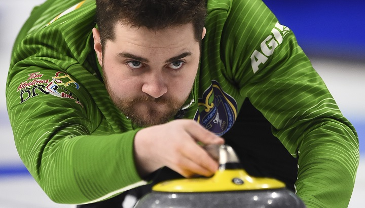 Team Saskatchewan skip Matt Dunstone delivers as they take on Team BC at the Brier in Kingston, Ont., on March 2, 2020.