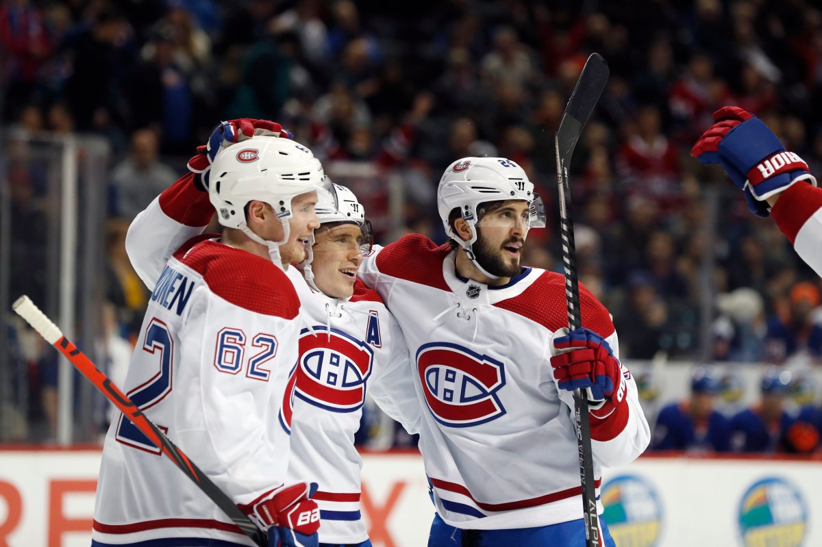 Montreal Canadiens right wing Brendan Gallagher, center, celebrates with left wing Artturi Lehkonen (62) and center Phillip Danault after scoring against the New York Islanders during the first period of an NHL hockey game Tuesday, March 3, 2020, in New York.