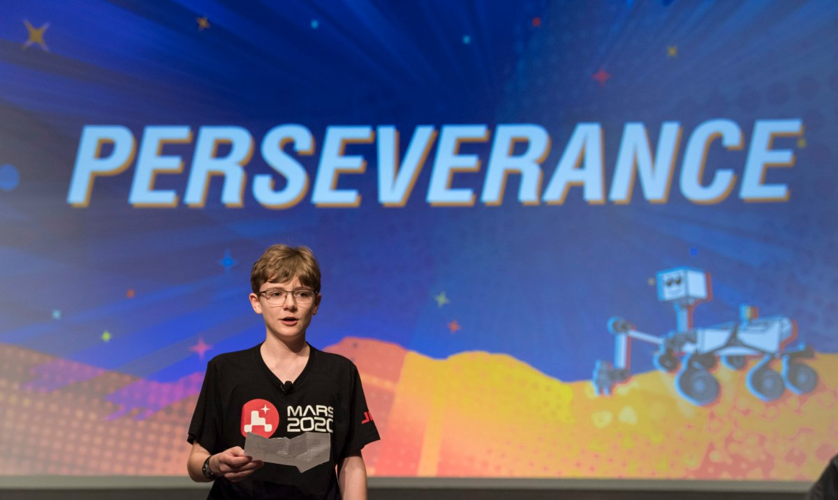 In this image released by NASA, Alex Mather, the student whose submission, Perseverance, was chosen as the official name of the Mars 2020 rover, reads his essay entry, Thursday, March 5, 2020, at Lake Braddock Secondary School in Burke, Va.