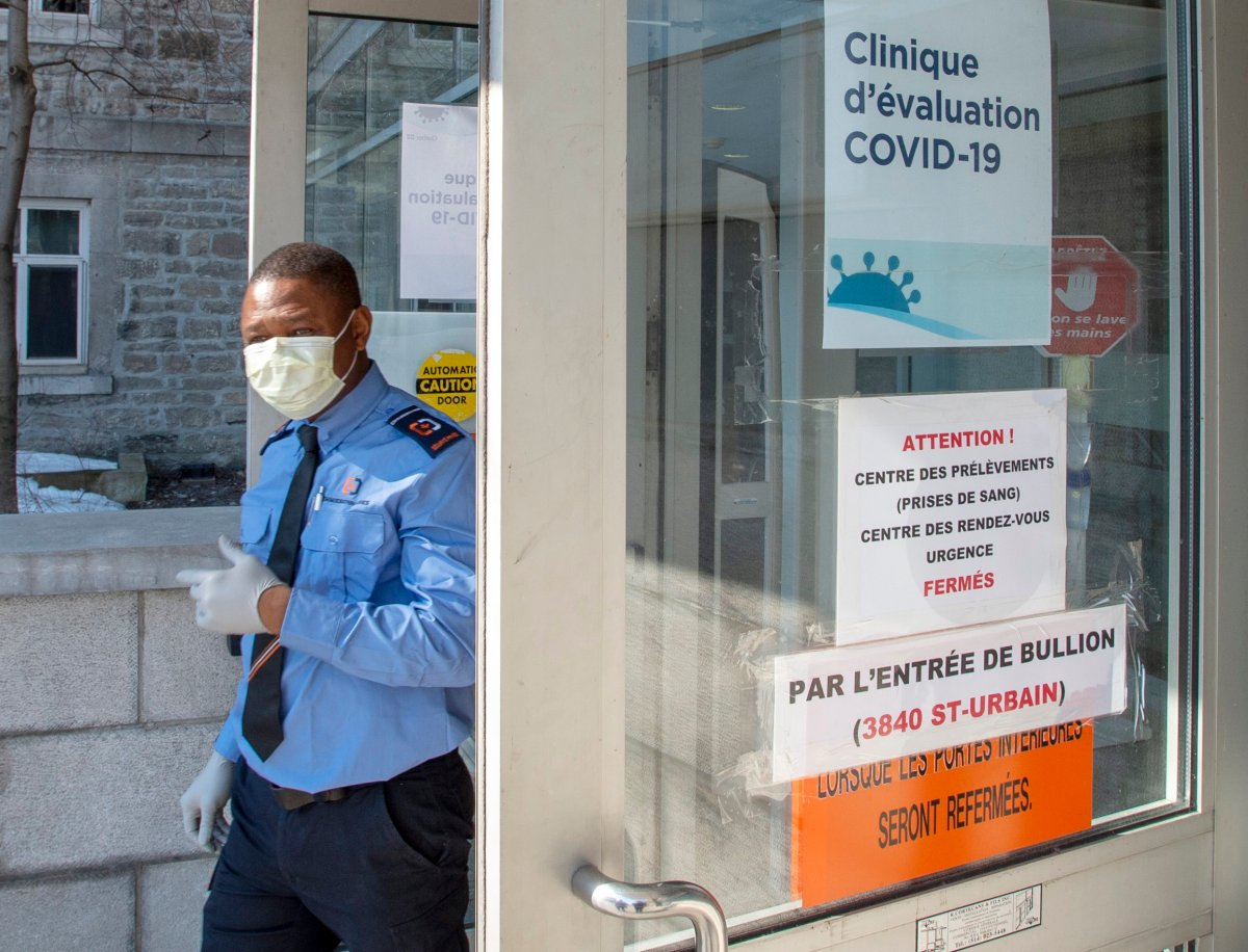In this March 2020 file photo, a security guard wears a protective mask in front of the new COVID-19 clinic at the site of the former Hôtel-Dieu hospital, The hospital is once again welcoming patients. Tuesday, Oct. 20, 2020.