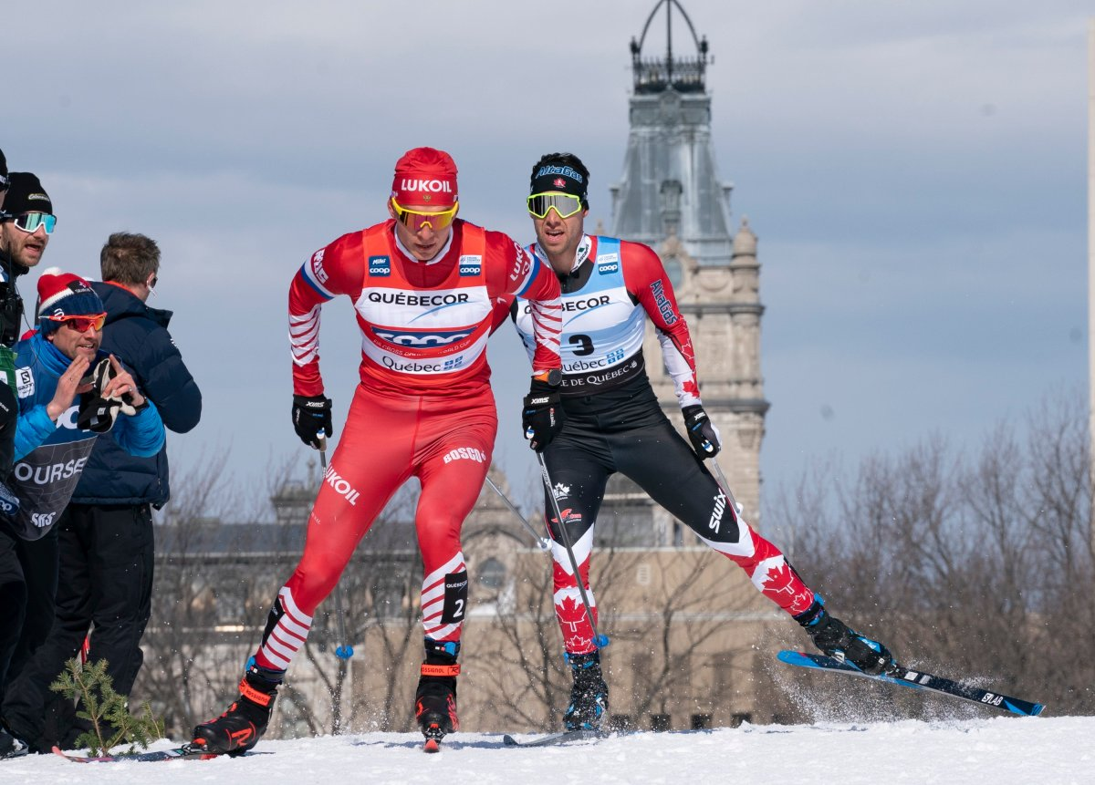 Alexander Bolshunov of Russia, left, and Alex Harvey of St-Ferreol-les-Neiges Que. race during the men's 15 km pursuit free Sunday, March 24, 2019 at the COOP FIS cross country world cup in Quebec City. The World Cup cross-country ski event this weekend in Quebec City has been cancelled because of the COVID-19 outbreak.