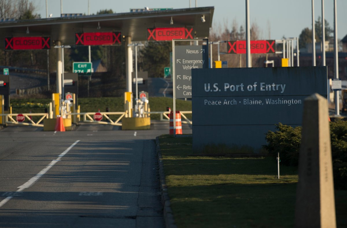 """The United States border crossing is pictured at the Peace Arch Canada/USA border in Surrey, B.C. Friday, March 20, 2020. New restrictions in effect at midnight Friday along Canada's shared border with the United States focus more on blocking tourists and bargain-hunters than on clearing the way for so-called """"essential"""" travel such as truckers hauling freight, health professionals and others who live on one side and work on the other."""