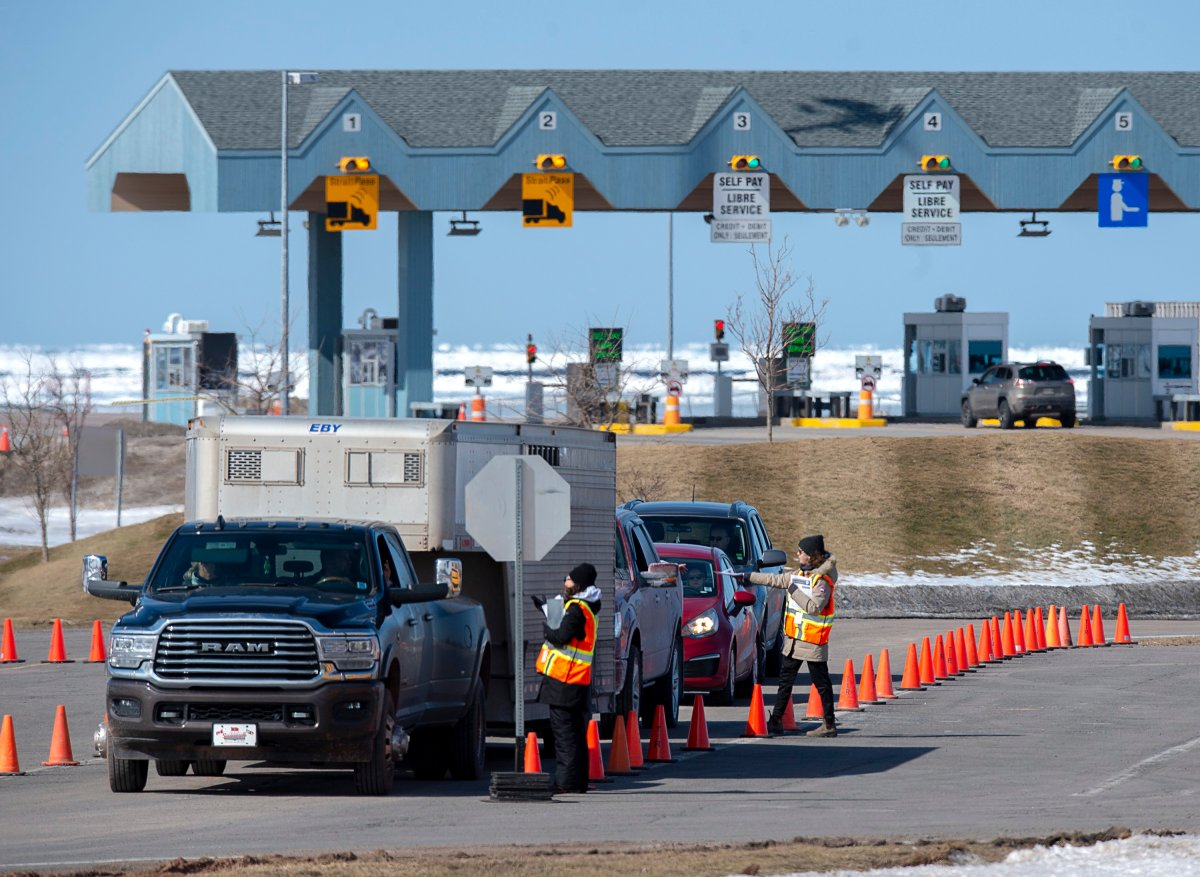 Provincial health department workers stop traffic that has crossed the Confederation Bridge in Borden-Carleton, P.E.I. on Sunday, March 22, 2020. Anyone arriving on Prince Edward Island from another province is told to self-isolate for 14 days.