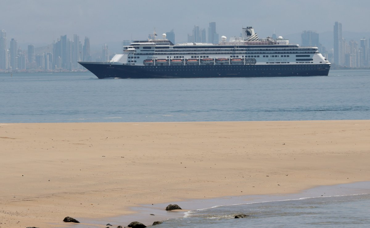 The Zaandam cruise ship, carrying dozens of guests with flu-like symptoms, arrives to the bay of Panama City, seen from Isla de Taboga, Panama, Friday, March 27, 2020, amid the worldwide spread of the new coronavirus. Once the vessel reaches Panamanian waters, health authorities are expected to board the ship to test passengers and decide whether it can cross the Panama Canal to head on towards Fort Lauderdale. (AP Photo/Arnulfo Franco).