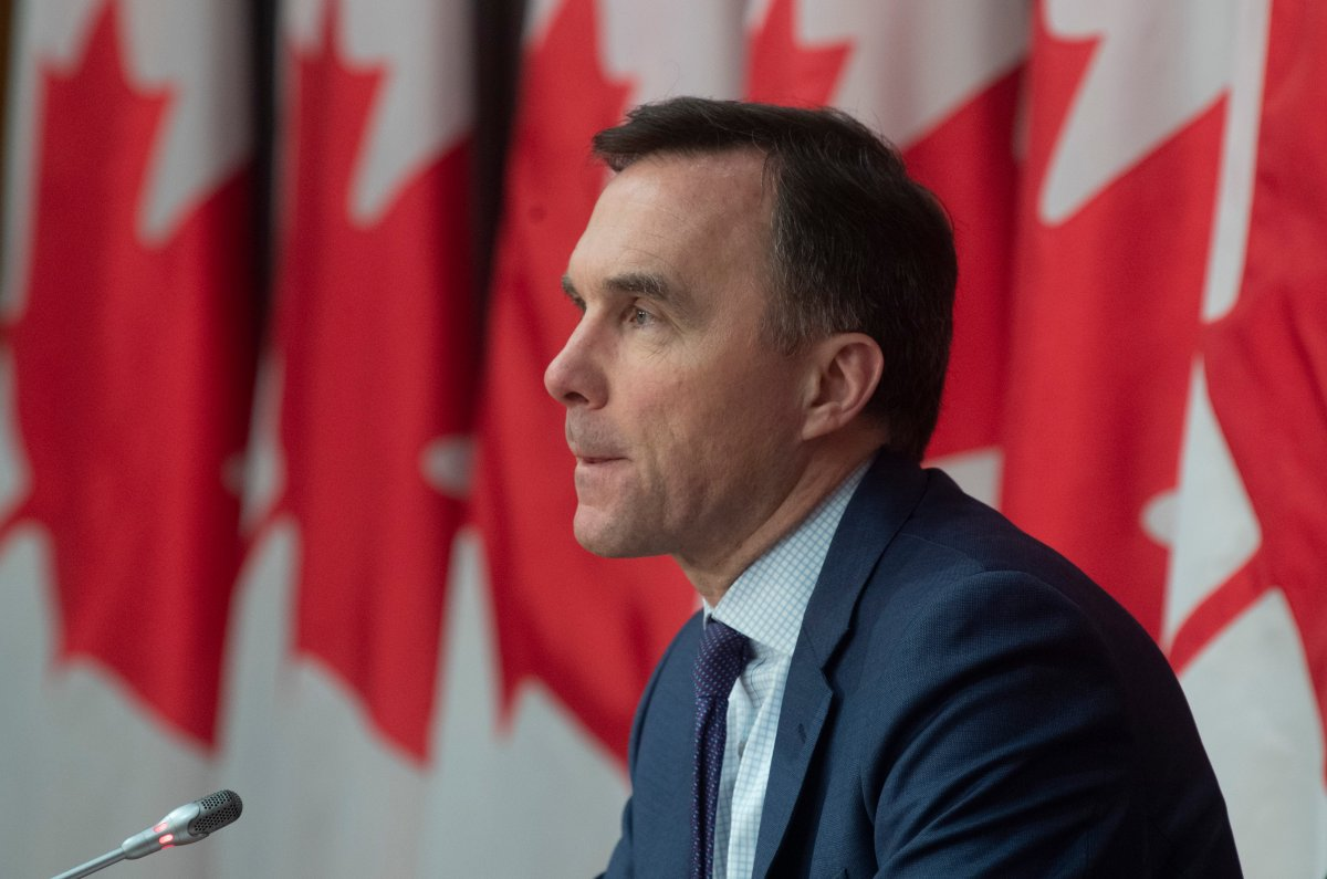 Minister of Finance Bill Morneau responds to a question during a news conference in Ottawa, Friday, March 27, 2020. Morneau was one of several MPs who met a UN official who tested positive for COVID-19.