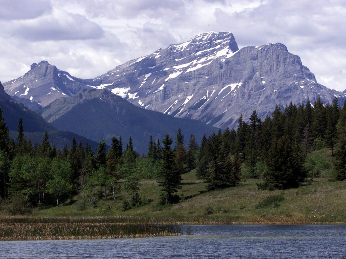 Mt McGillivray is seen in the distance over Middle Lake in the Bow Valley Provincial Park, Saturday June 18, 2000.