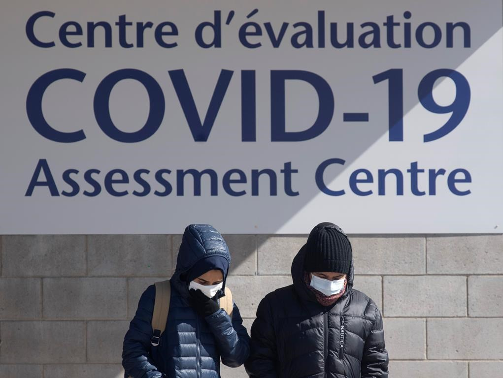 People leave a COVID-19 assessment centre Saturday, March 14, 2020 in Ottawa. THE CANADIAN PRESS/Adrian Wyld.