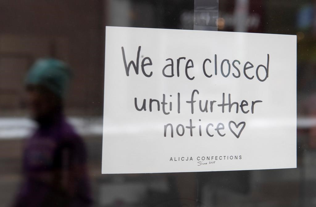 A sign on a shop window indicates the store is closed in Ottawa, Monday March 23, 2020. . THE CANADIAN PRESS/Adrian Wyld.