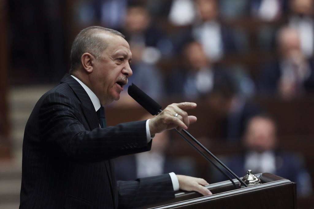 Turkish President Recep Tayyip Erdogan4 addresses the members of his ruling party in Parliament, in Ankara, Turkey, Wednesday, March 4, 2020.