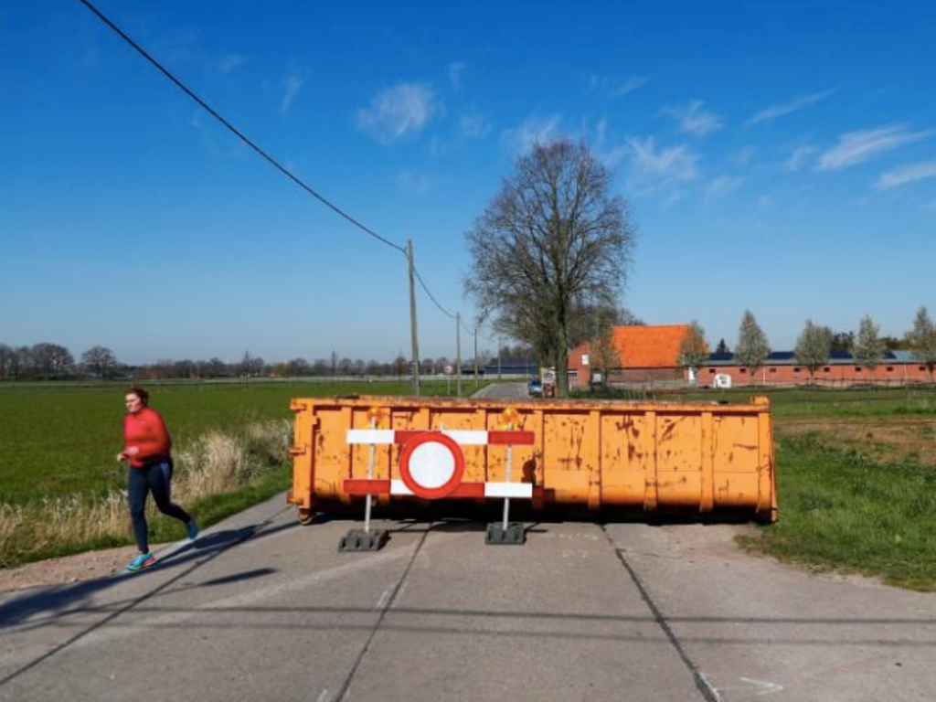 A container is pictured in a street on the Dutch-Belgian border during the coronavirus lockdown imposed by the Belgian government in an attempt to slow down the coronavirus disease (COVID-19) spread, near Hoogstraten, Belgium March 25, 2020.