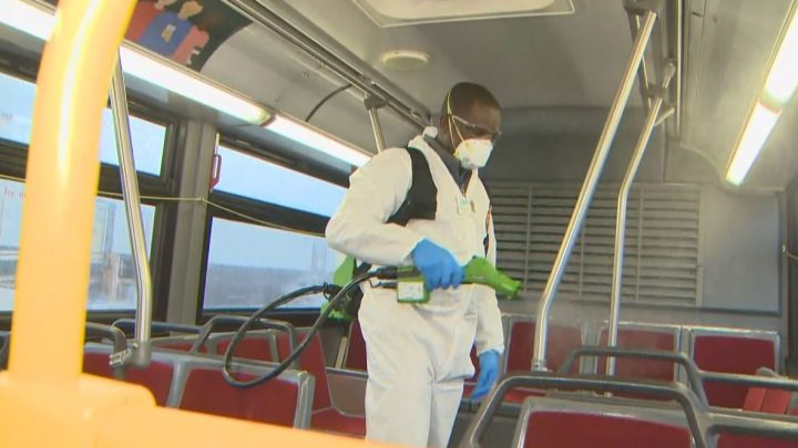 Cleaners disinfect a TTC bus during a demonstration on March 3.