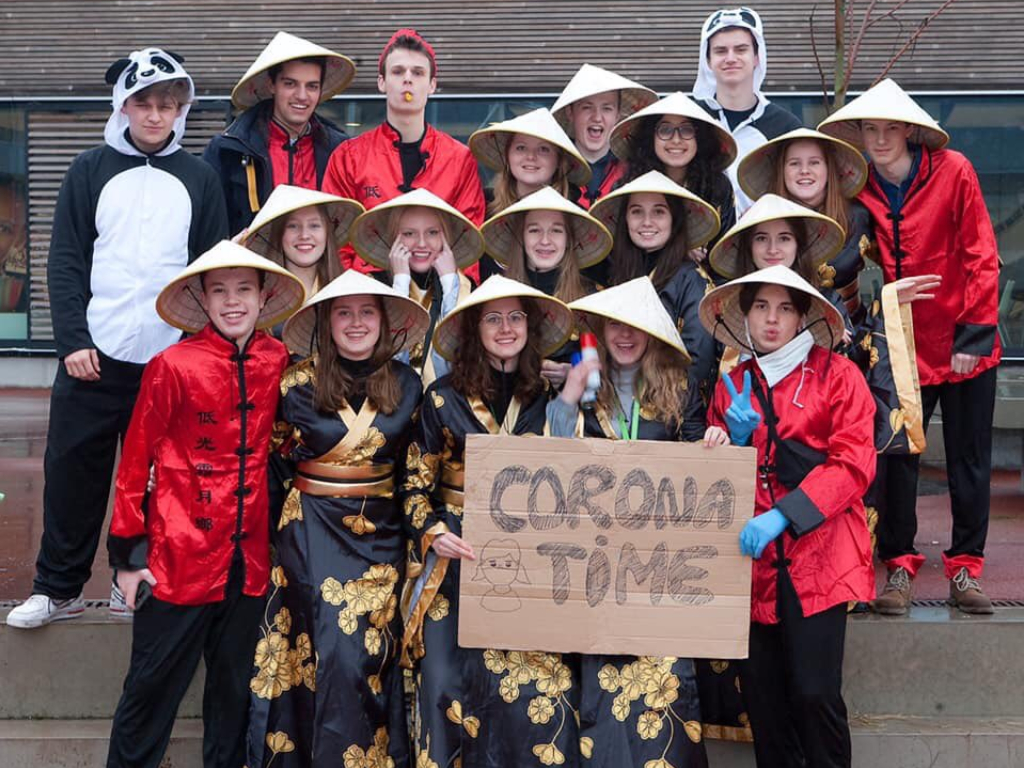 """A group of Sint Paulus school students in Belgium posed in stereotypical Chinese clothing and held up a """"Corona Time"""" sign."""