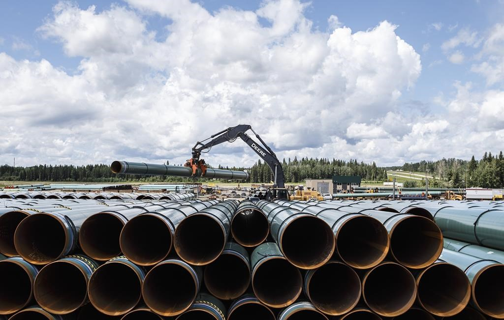 Pipe for the Trans Mountain pipeline is unloaded in Edson, Alta., Tuesday, June 18, 2019.