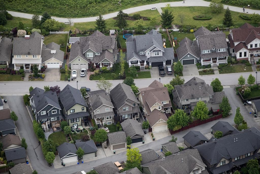 Houses are seen in an aerial view in Langley, B.C., on Wednesday May 16, 2018.