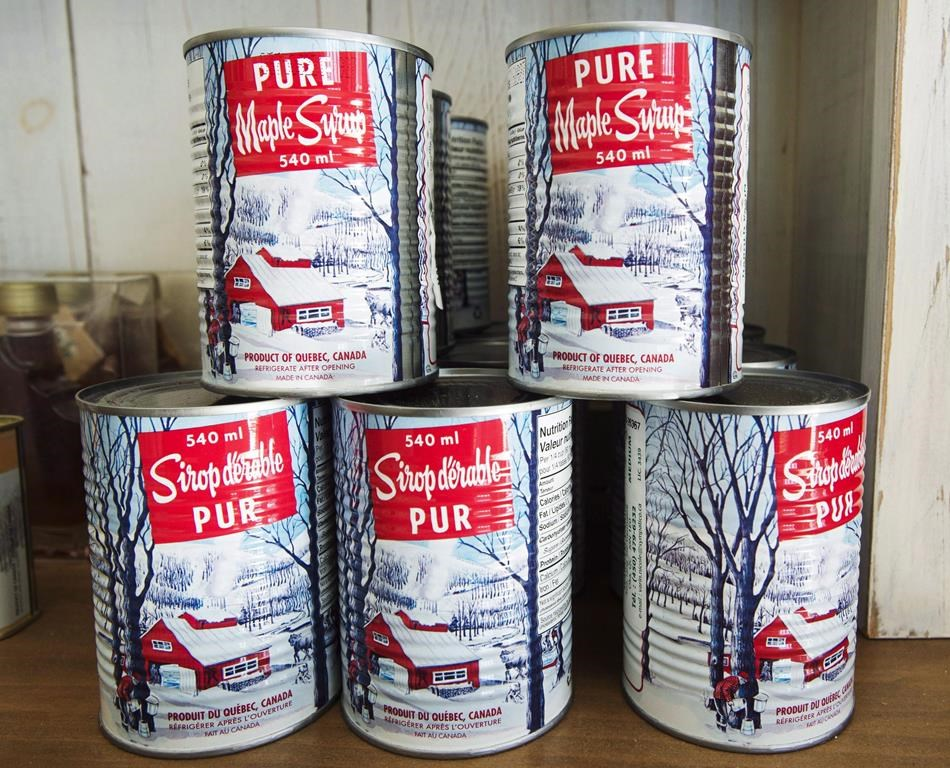 Maple syrup cans are seen at a sugar shack Friday, February 10, 2017 in Oka, Que. When it comes to maple syrup production in Canada, Quebec dominates, but a claim by Ontario of being second has left a sour taste in the mouth of some producers in New Brunswick. THE CANADIAN PRESS/Ryan Remiorz.