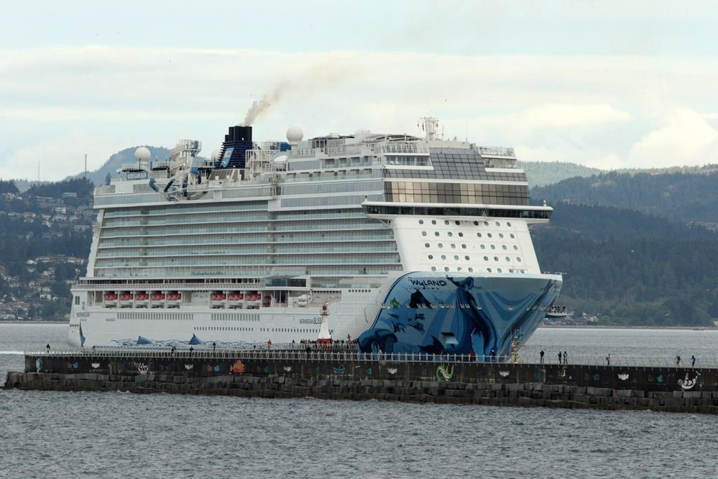The Norwegian Bliss en route from Alaska to Seattle makes it's way towards Ogden Point in Victoria, B.C., on Friday June 1, 2018. Transport Canada's decision to suspend the cruise season until July 1 will mean 114 cancelled cruise ship arrivals and almost 300,000 fewer passengers this spring and summer, says the harbour authority's chief executive officer. THE CANADIAN PRESS/Chad Hipolito.