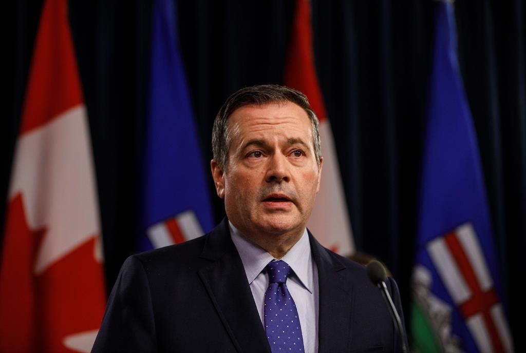 Alberta Premier Jason Kenney updates media on measures taken to help with COVID-19, in Edmonton on Friday, March 20, 2020. THE CANADIAN PRESS/Jason Franson.