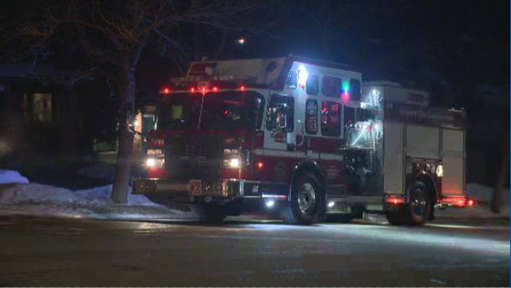 A woman was pulled from a house fire on Edgehill Drive N.W. in north Calgary on Sunday, March 8, 2020.