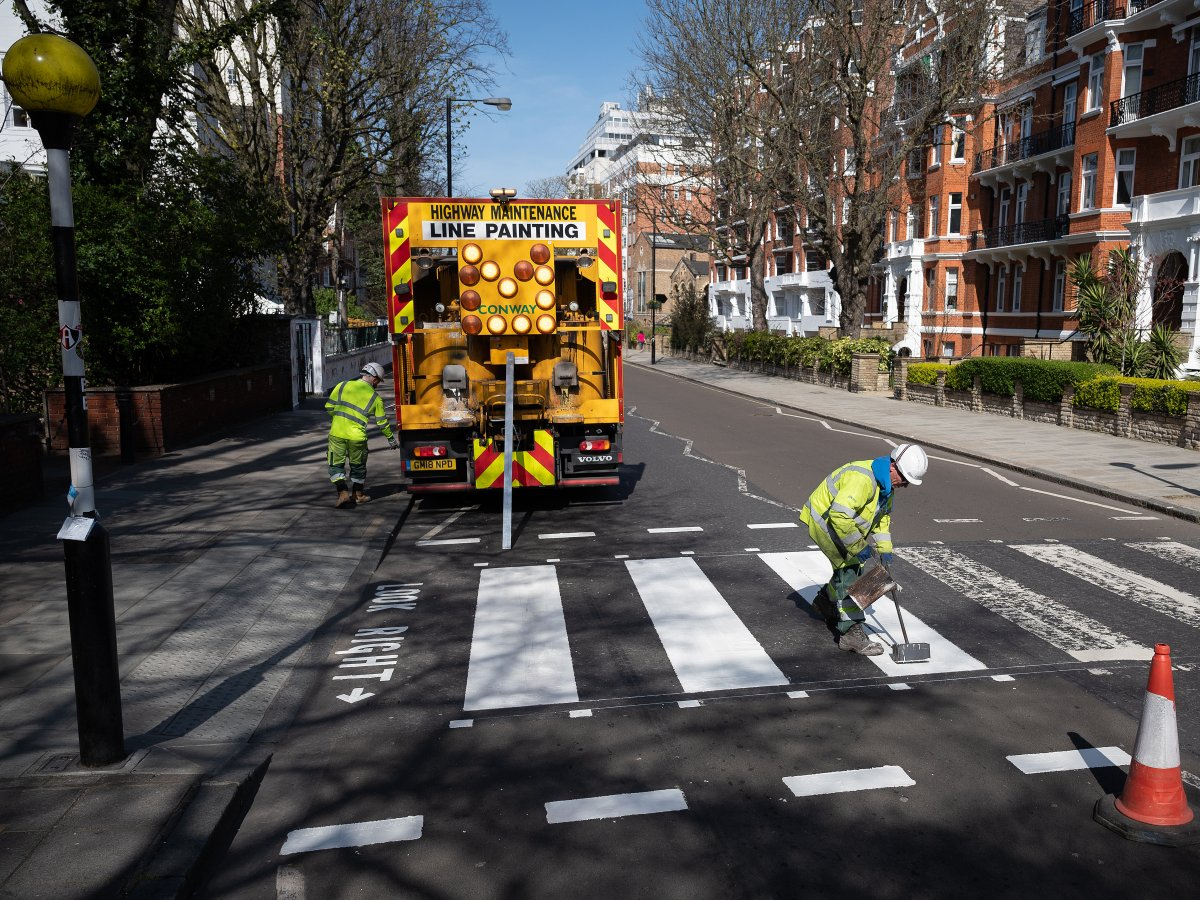 A Highways Maintenance team takes advantage of the COVID-19 coronavirus lockdown and quiet streets to re-paint the iconic Abbey Road crossing on March 24, 2020 in London, England.