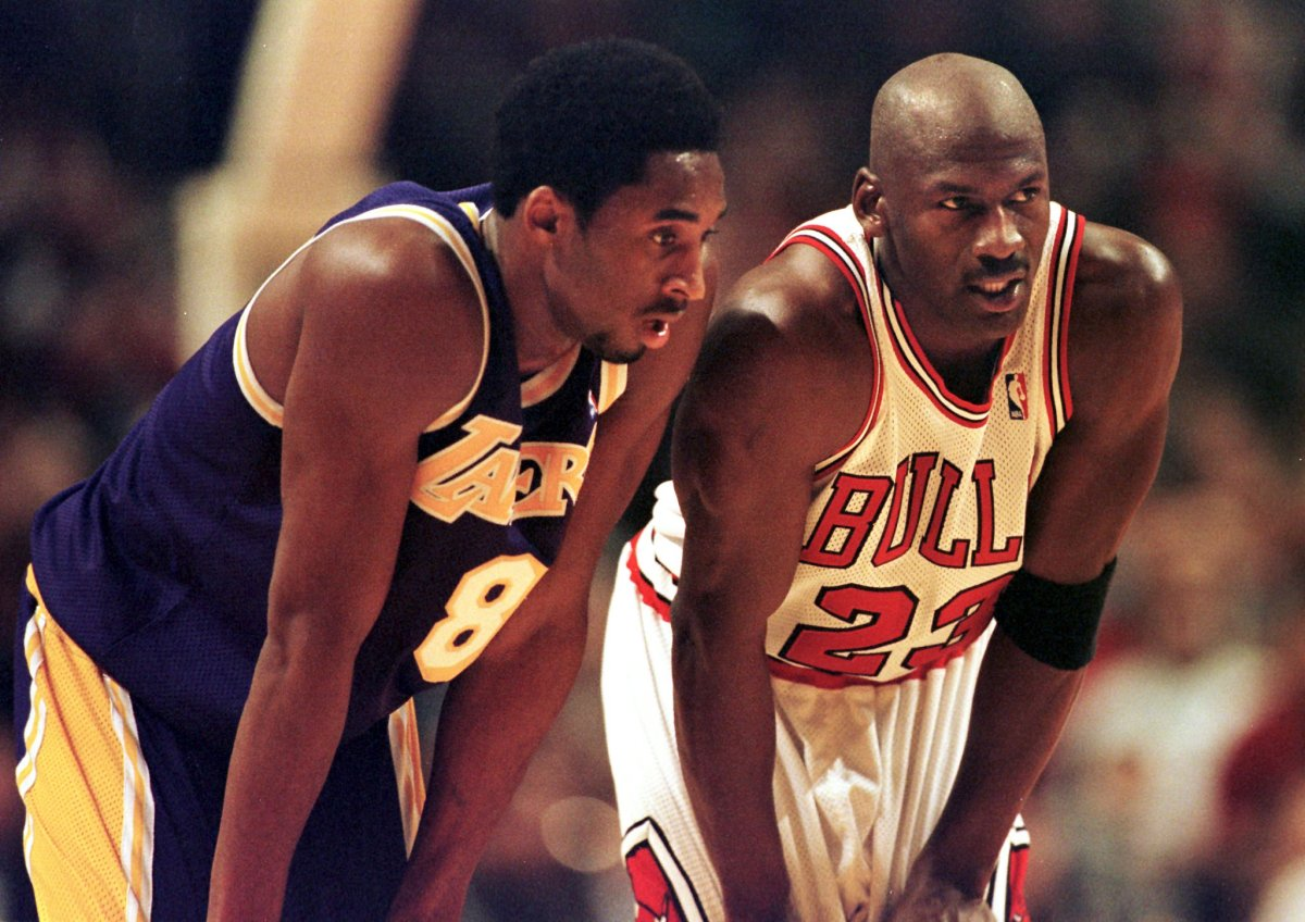 Los Angeles Lakers guard Kobe Bryant (L) and Chicago Bulls guard Michael Jordan (R) talk during a free-throw attempt during the fourth quarter of a game at the United Center in Chicago.