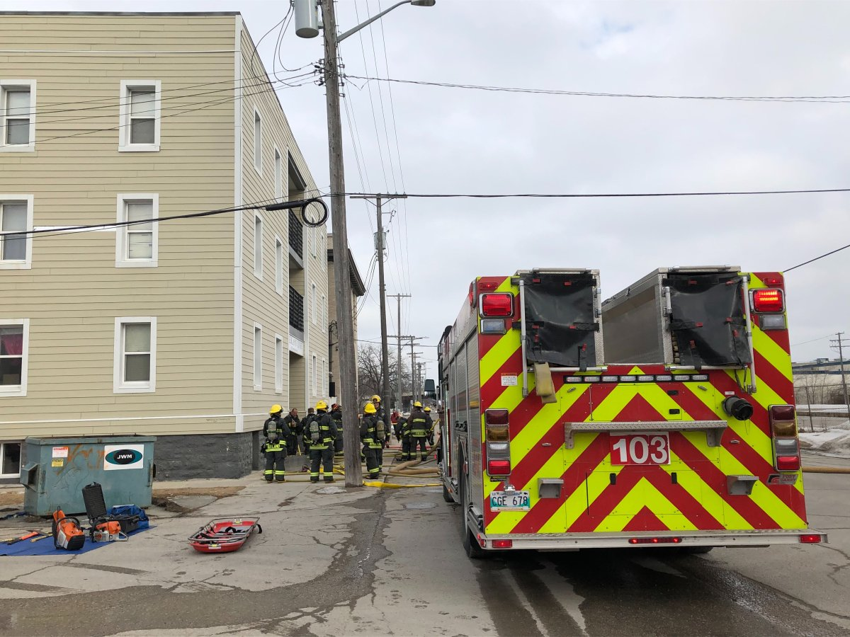 Fire crews at a fire at an apartment building in Point Douglas.