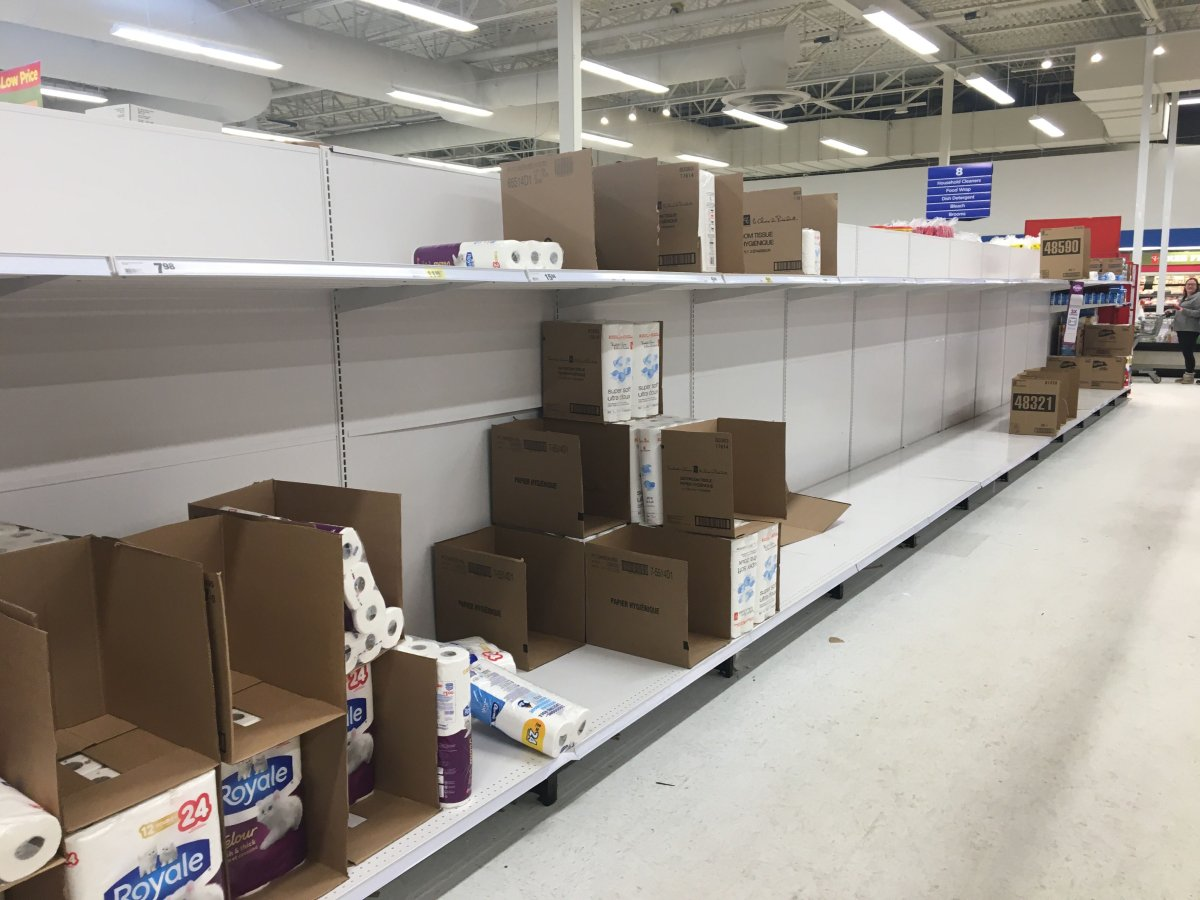 Bare toilet paper shelves inside a Superstore in Edmonton, Alta. on Saturday, March 7, 2020.