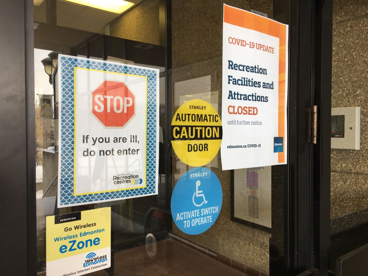 Signs posted on Saturday, March 15, 2020 at the Kinsmen Sports Centre in Edmonton stated that the city's recreation facilities and attractions were closed.