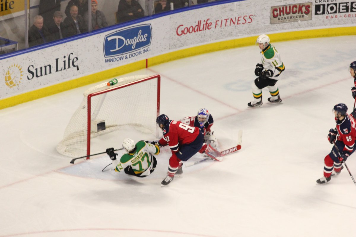 London, Ont. - Matvey Guskov of the London Knights gets dragged down going to the net in a game played at Budweiser Gardens during the 2019-20 season.