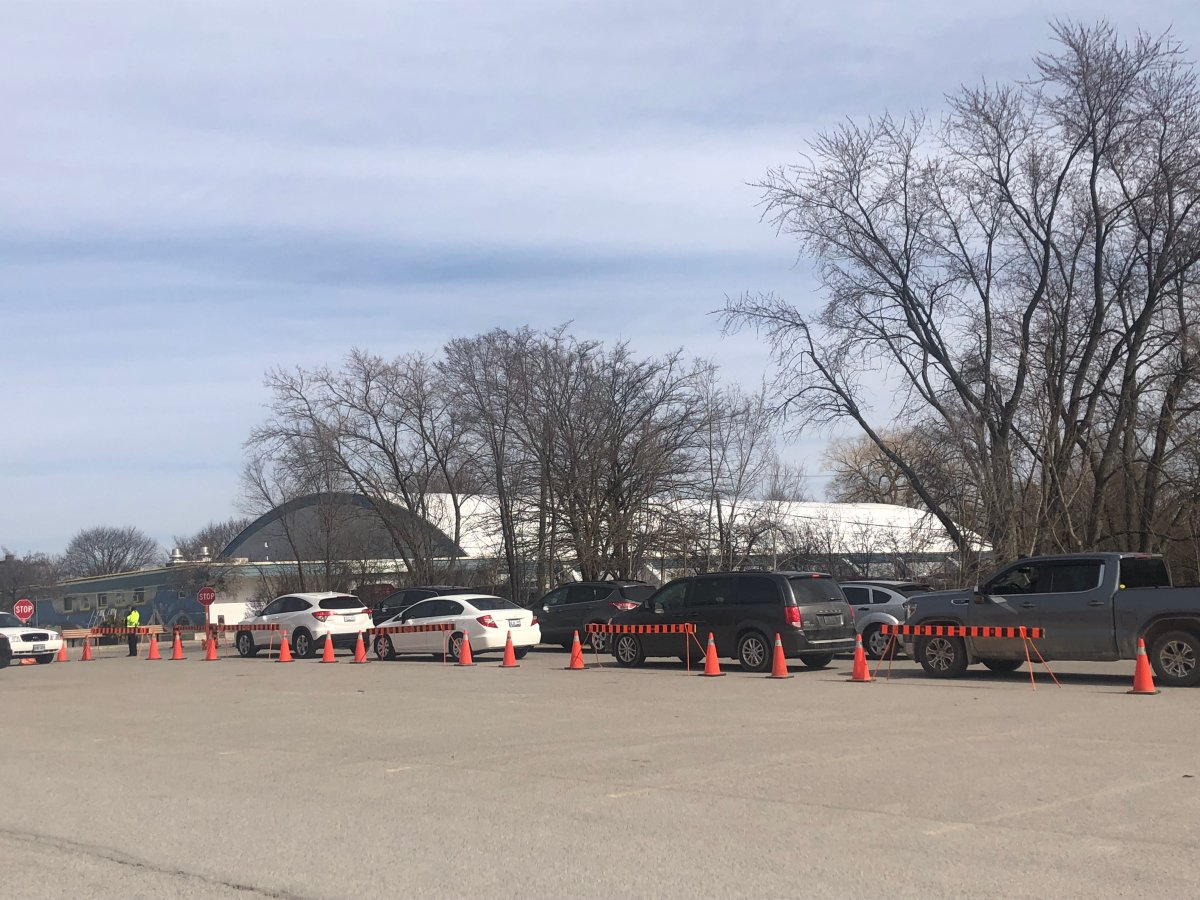 Cars line up outside Oakridge Arena on Monday morning to access London's COVID-19 assessment centre.