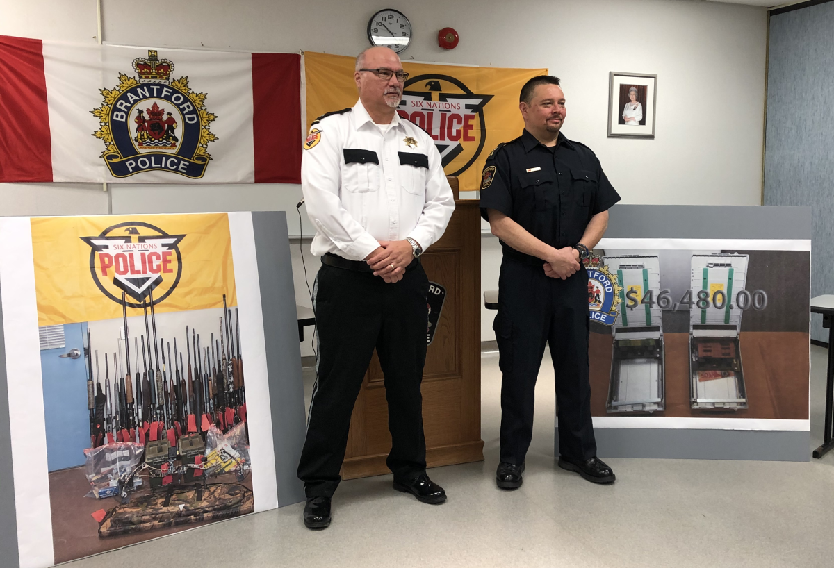 Six Nations Police inspector Darren Montour (left) and Brantford Police Chief Rob Davis (right) announced that two Ohsweken men are facing hundreds of charges in connection with three dozen ATM thefts across southern Ontario.