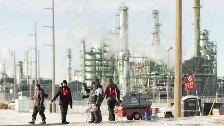 Members of Unifor 594 walk the picket line at the Co-op Refinery in Regina in January.