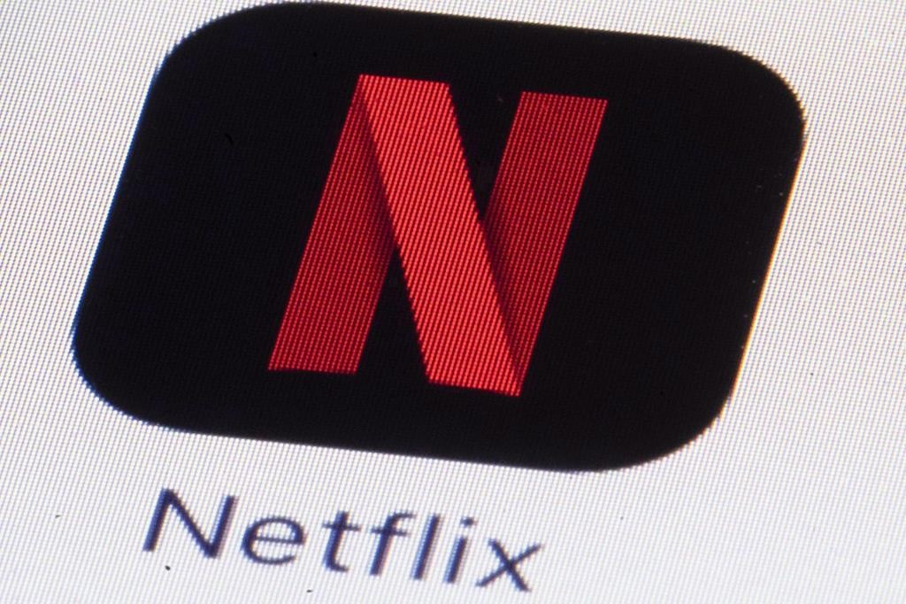 The Netflix logo is shown on an iPhone in Philadelphia on Monday, July 17, 2017. Netflix is lowering video quality for its subscribers in Canada as the streaming giant attempts to reduce soaring demands on internet bandwidth. THE CANADIAN PRESS/AP, Matt Rourke.