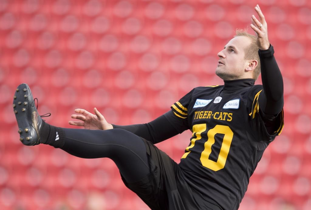 Hamilton Tiger-Cats Lirim Hajrullahu is seen during a practice prior to the 107th Grey Cup in Calgary on November 23, 2019. The COVID-19 pandemic has put Lirim Hajrullahu's NFL aspirations on hold. The former Hamilton Tiger-Cat participated in a free-agent camp March 8 and garnered attention from at least four NFL teams. But with NFL facilities closed and travel suspended because of the novel coronavirus, the resident of Oakville, Ont., is trying to stay patient for his opportunity to audition in private workouts. THE CANADIAN PRESS/Nathan Denette.