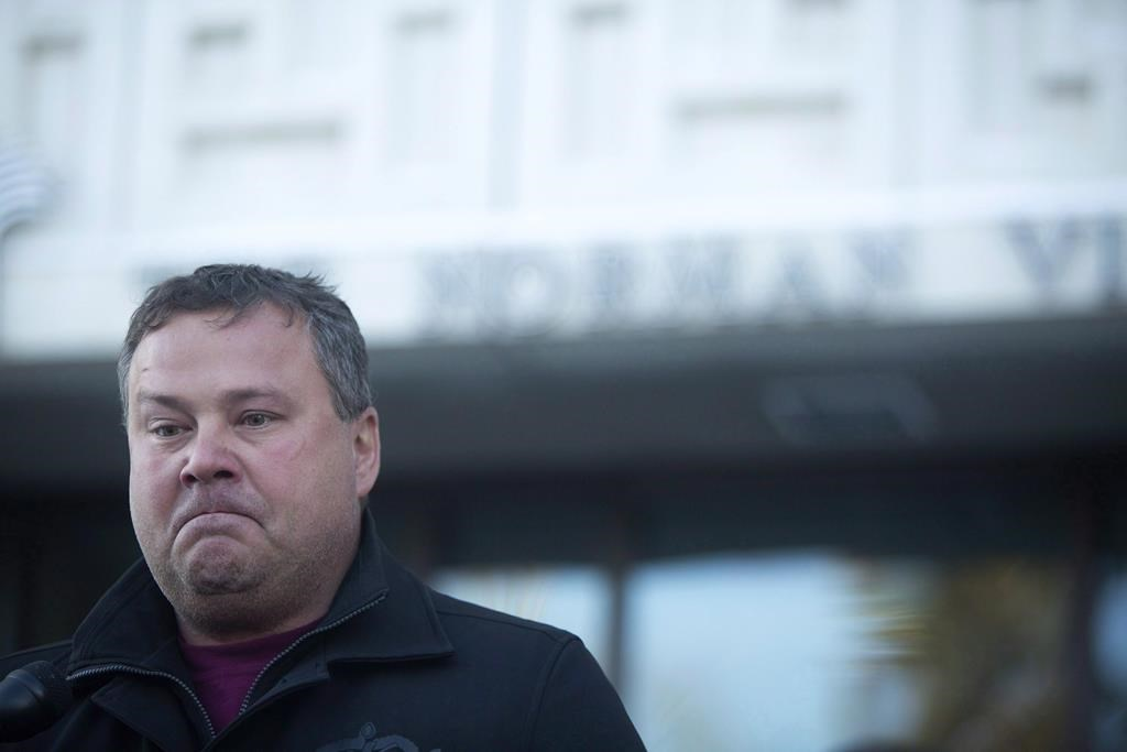 Scott Thomas, father of Humboldt Broncos bus crash victim Evan Thomas, speaks to media outside provincial court in Melfort, Sask., on January 8, 2019. A father whose son was killed in the deadly Humboldt Broncos collision says he worries the Saskatchewan Government's move to relax some trucking rules around COVID-19 may mean drivers will be pushed past their limits.
